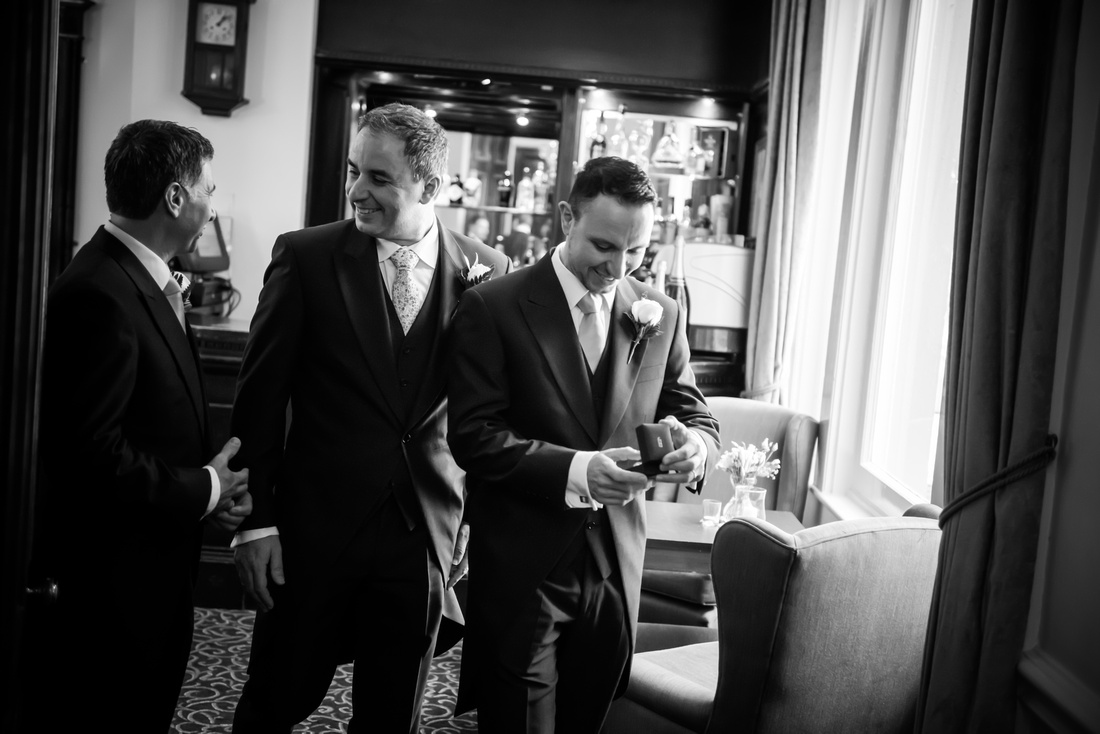 Black and white image of the groom and his ushers before the wedding at Taplow House.