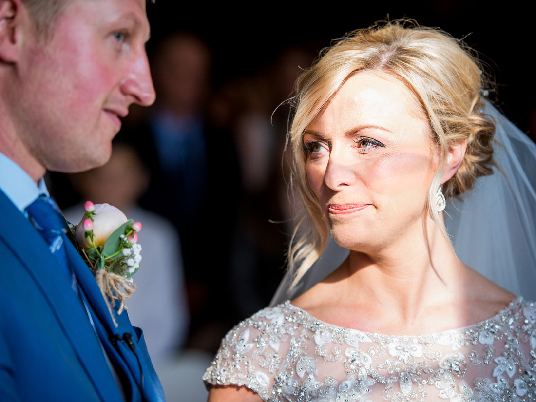 Photo of the bride gazing at her groom during the wedding ceremony in Portmeirion.