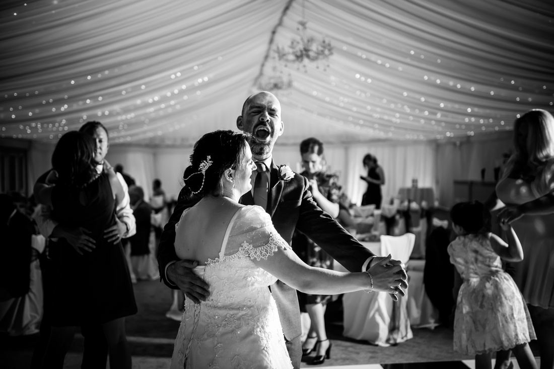 Black and white image of the bride and groom during their first dance as a married couple at Soughton Hall.