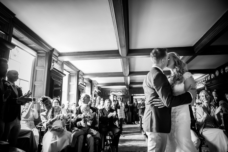 Black and white image of the bride and groom kissing for the first time as husband and wife at Bodrhyddan Hall.