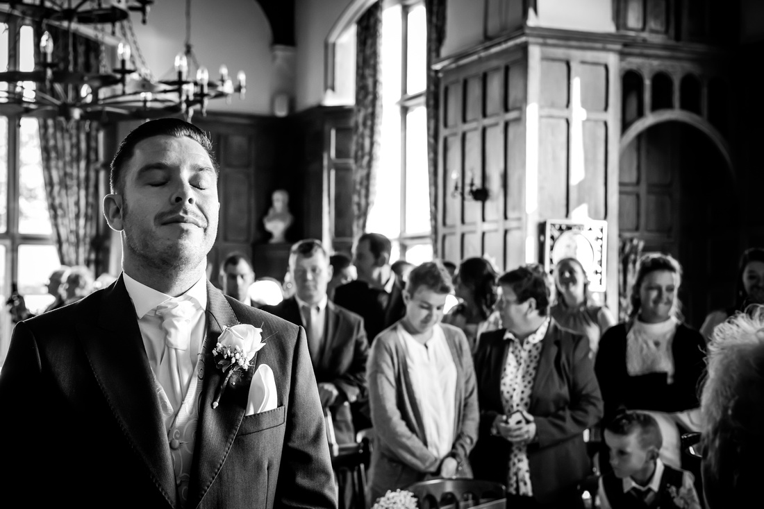 Black and white image of a nervous groom at a wedding at Chateau Rhianfa.