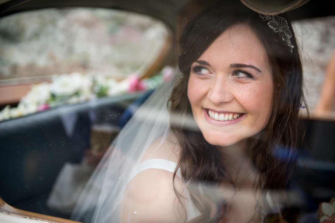 Image of the bride in the car on her way to her wedding reception at Plas Isaf.