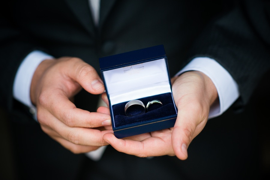 Groom holding the wedding rings at Tre-Ysgawen
