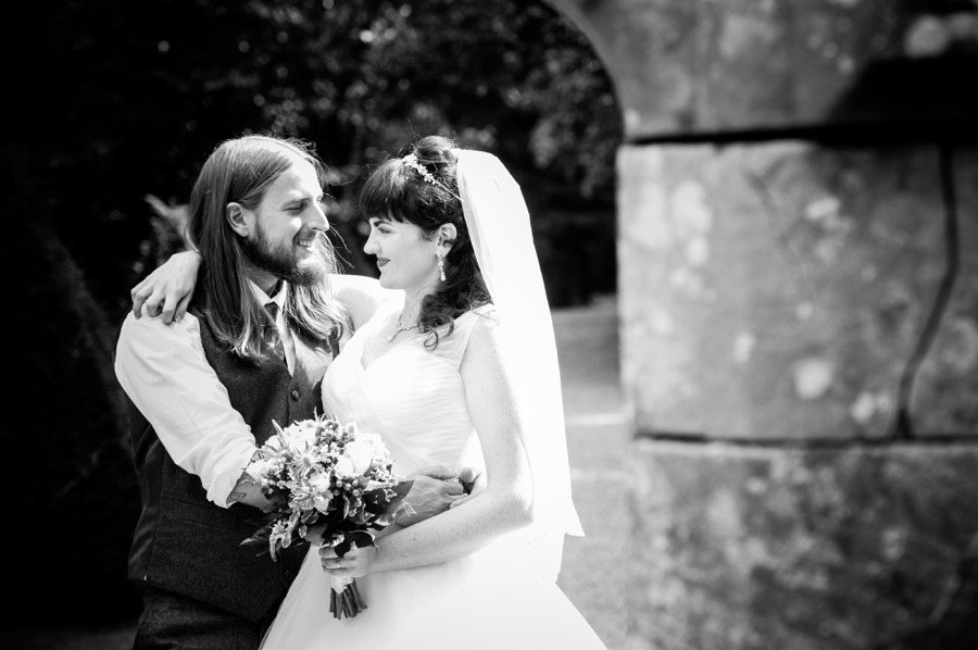 Black and white image of bride and groom at their wedding at Gwydir Castle, by Celynnen Photography, North Wales wedding photographer of the year