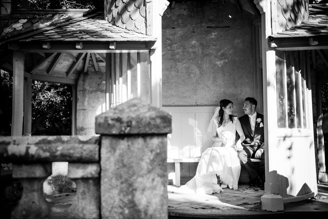 Black and white image of the bride and groom in the grounds of Chateau Rhianfa on their wedding day.