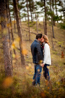 An engaged couple sharing a kiss in their pre wedding photoshoot, captured by Celynnen Photography