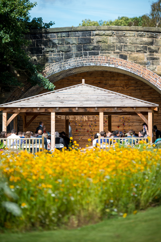 Colourful image of the location of a wedding ceremony at Tower Hill Barns.