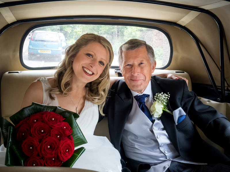 Photo of the bride and her father arriving for the wedding ceremony in Davenham.
