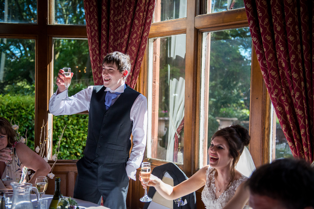 Image of the groom giving his speech, from his wedding at Ruthin Castle.
