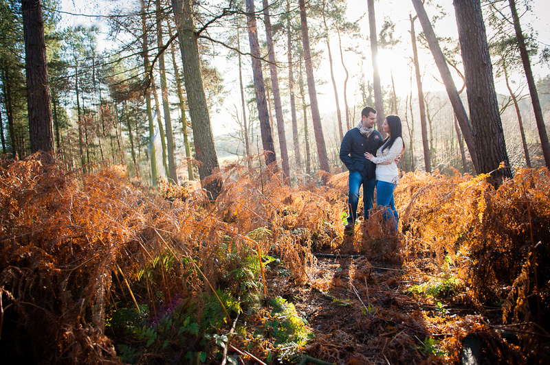 Colourful picture of a couple standing in a forest for their pre wedding photo shoot.