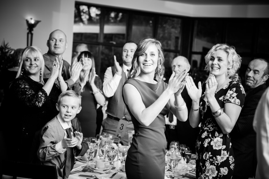Guests clapping for couple at wedding by North Wales Wedding Photographer Celynnen Photography