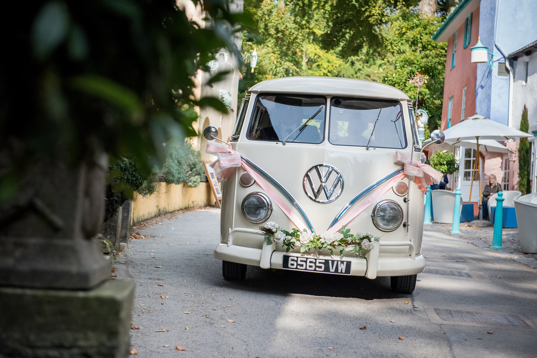 Photo of the car that the bridal party arrived to the wedding venue in, which was in Portmeirion.