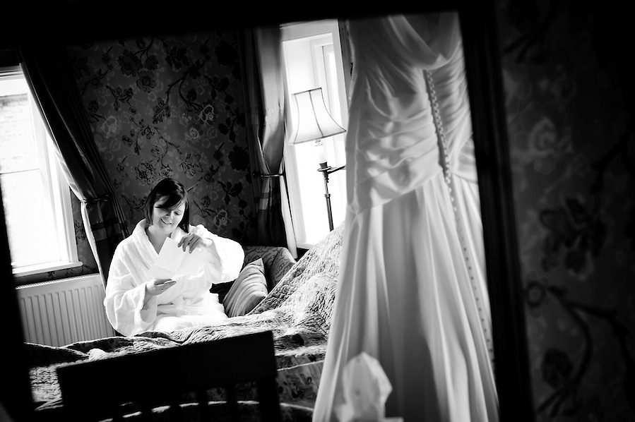 Bride reads a letter from her Groom on the morning of their wedding (Ioan Said / Celynnen Photography)
