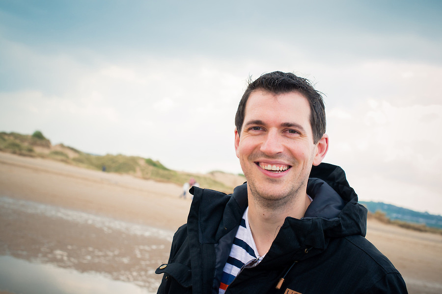 A happy man on his pre wedding photo shoot on Talacre Beach.