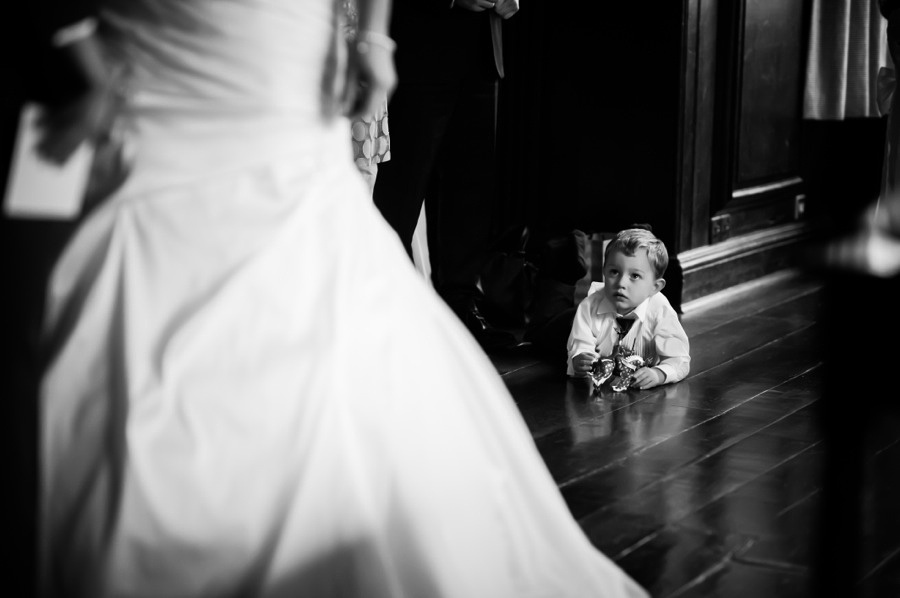 Child looking at Bride at Wedding by Photographer Celynnen Photography