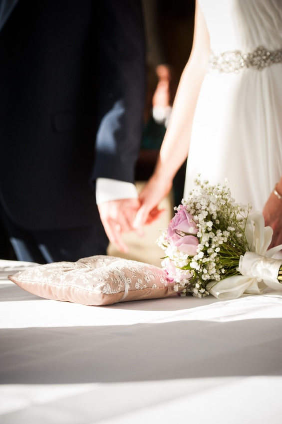 Bride and Groom holding hands at altar by North Wales Wedding Photographer Celynnen Photography