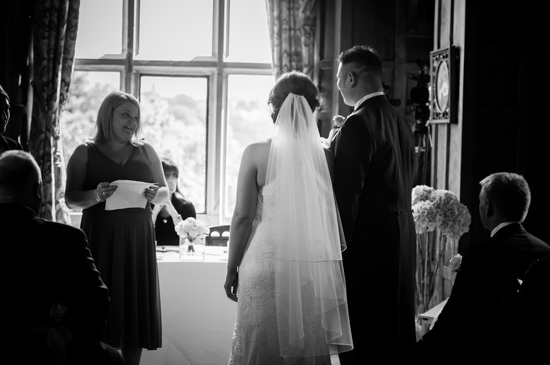 Black and white image of someone doing a reading at a wedding in Chateaux Rhianfa, Anglesey. Wedding Photographer, Celynnen Photography