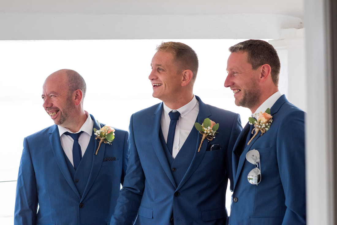 A photo of the ushers ready for a wedding day in Portmeirion.