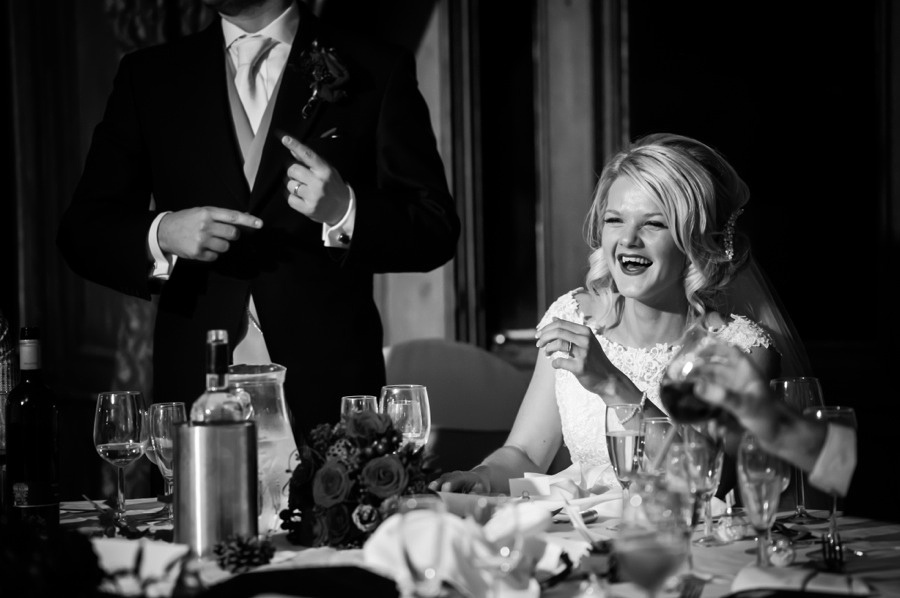 Bride and Groom happy at their evening reception by photographer Celynnen Photography