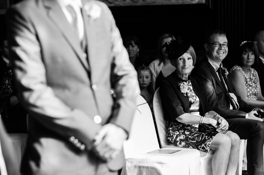 Mother of the bride looking on. wedding in Portmeirion. Wedding photographer, Celynnen Photography