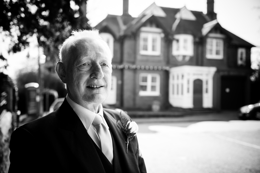 Black and white image of the father of the bride at a wedding in Buckinghamshire.
