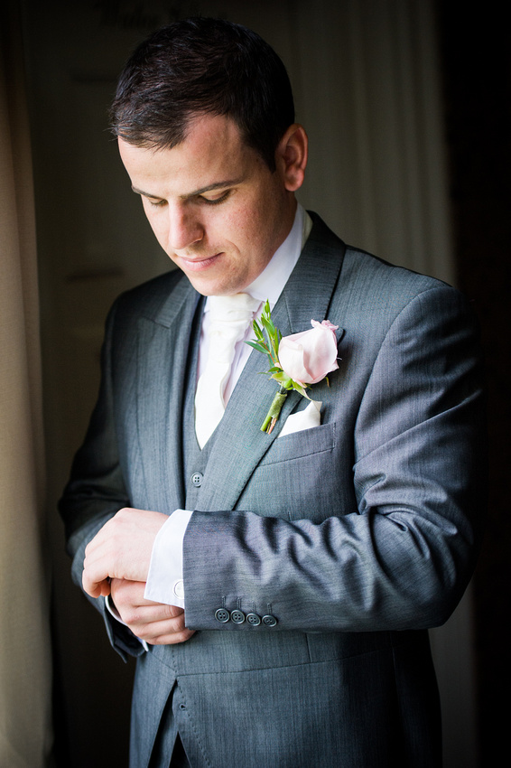 Groom getting dressed for his wedding at Chateaux Rhianfa, Anglesey. Wedding Photographer, Celynnen Photography