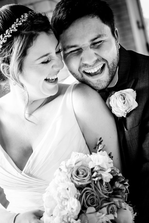 Couple laughing at their wedding  at Seiont Manor