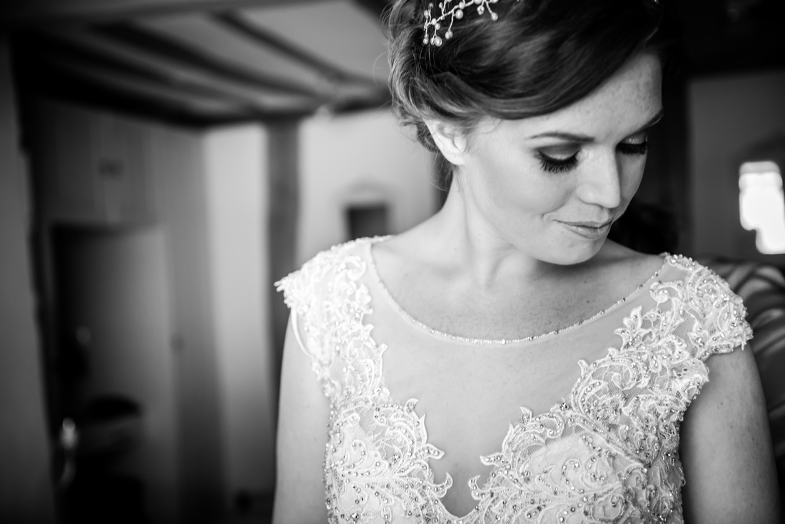 Black and white image of the bride during bridal preparations for a wedding at Tower Hill Barns.
