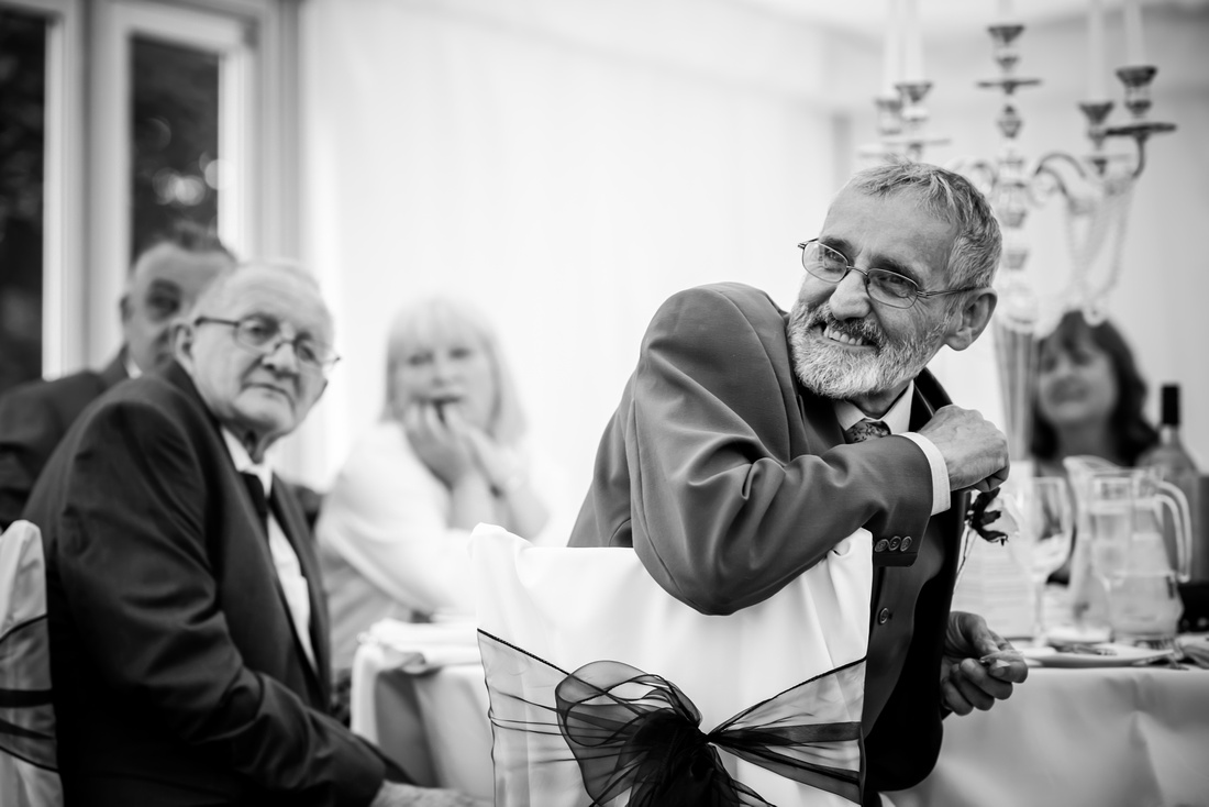 Black and white images of the guests at a wedding at Soughton Hall.