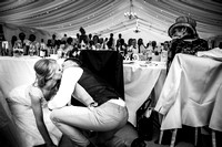 bride and groom kissing in the marquee at their wedding at Bodrhyddan Hall