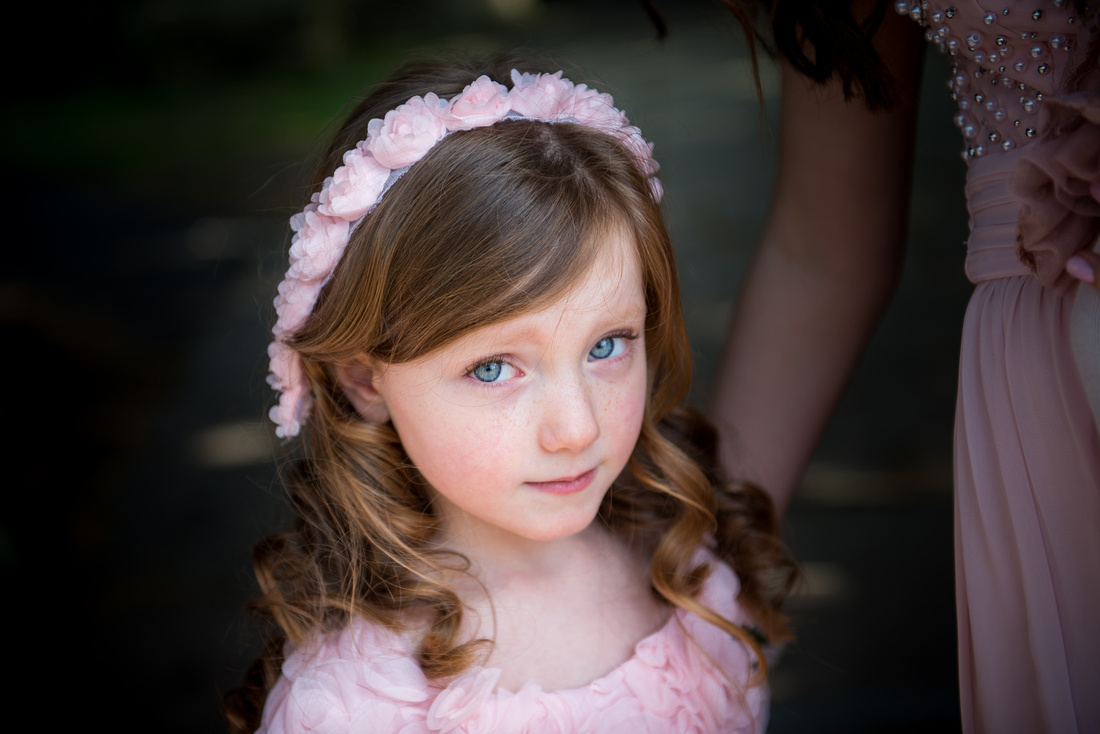 Portrait of a flower girl at a wedding in Buckinghamshire.