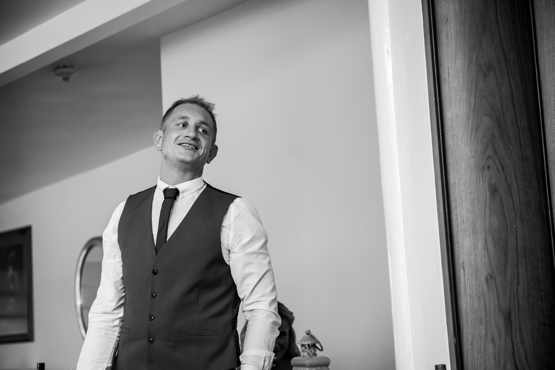 Black and white image of one of the ushers during the speeches at a wedding in Portmeirion.