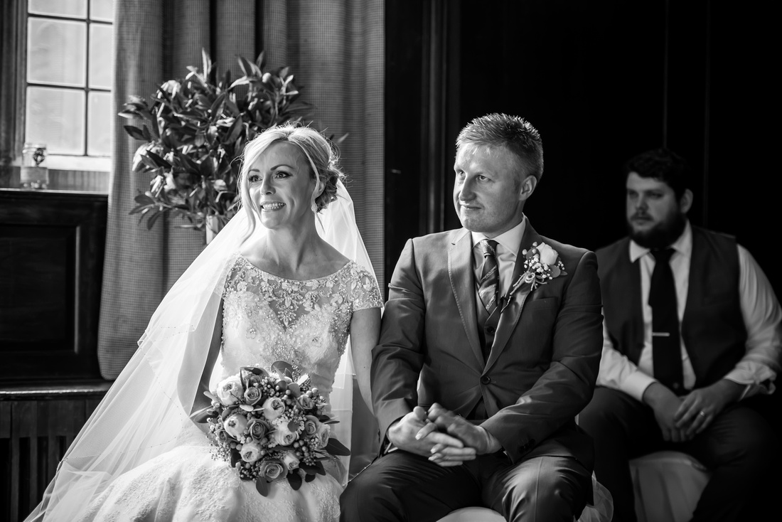 Black and white image of the bride and groom during the wedding ceremony in Portmeirion.