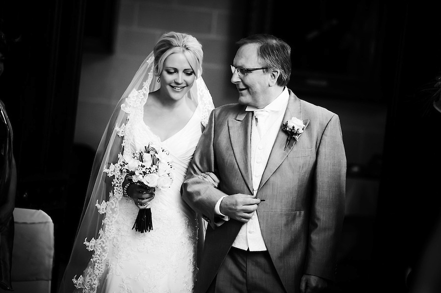 Father of the bride proudly walker her down the aisle at her wedding in Plas Newydd in Anglesey (Ioan Said / Celynnen Photography)