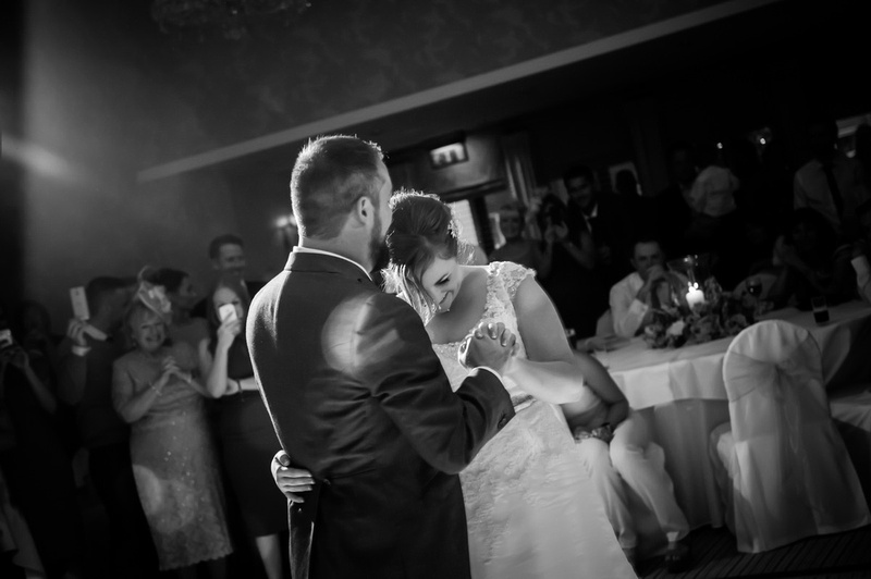 Black and white image of the bride and groom having their first dance at Rowton Hall.