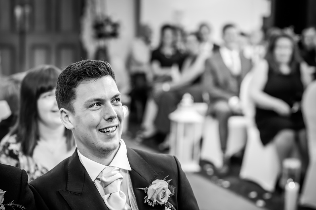 Black and white image of the groom before the wedding ceremony at The Kinmel