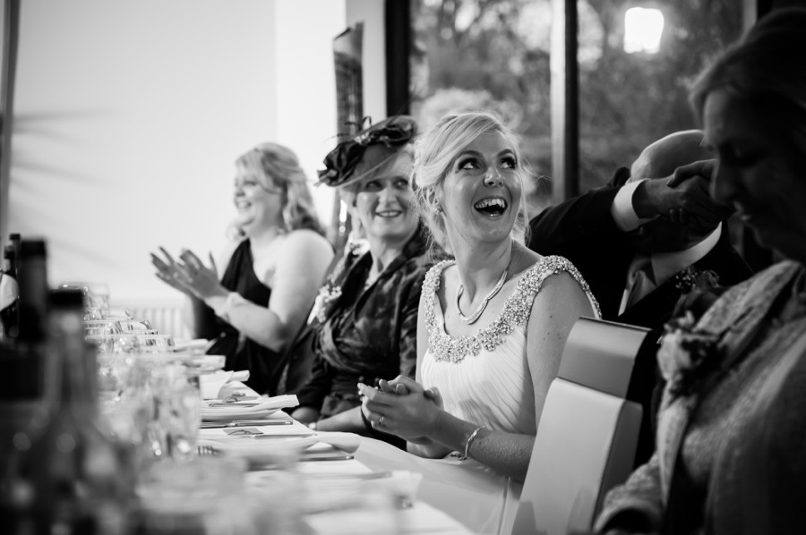 Bride laughing during speeches by North Wales Wedding Photographer Celynnen Photography