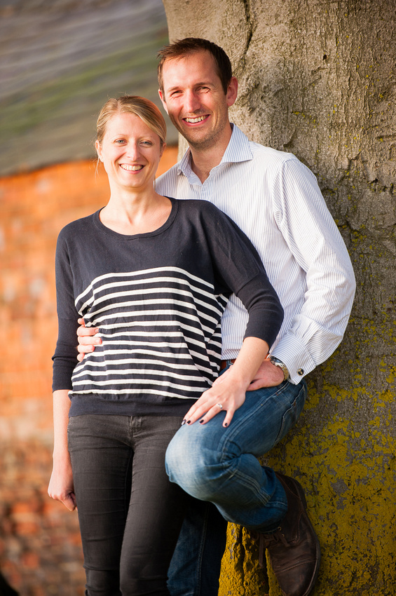 Portrait of couple leaning against a tree in Cheshire.