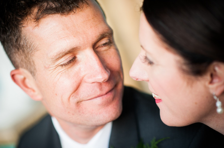 Groom smiling at Bride on Wedding Day by Photographer Celynnen Photography