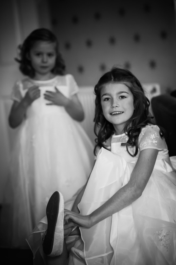 Flower girls getting ready for the wedding by Photographer Celynnen Photography