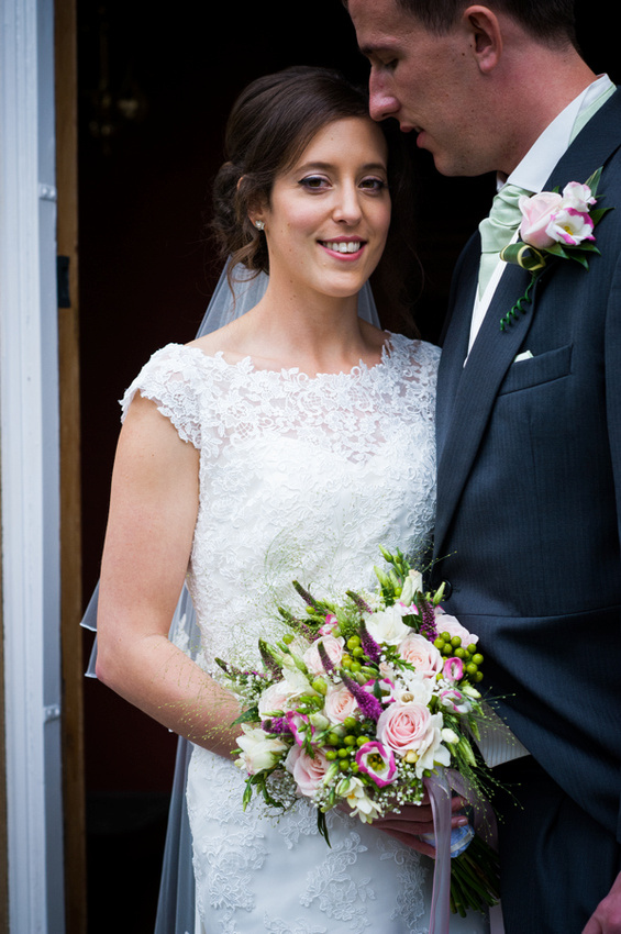Smiling Bride Next to her Husband by North Wales Wedding Photographer Celynnen Photography