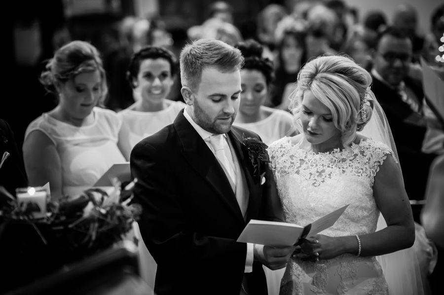 Bride and Groom at Altar by Photographer Celynnen Photography