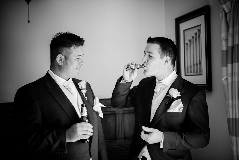 The groom and his brother having a drink before wedding in Chateaux Rhianfa, Anglesey. Wedding Photographer, Celynnen Photography
