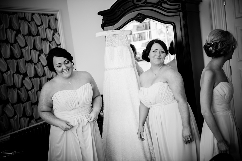 Black and white image of bridesmaids at a wedding in Chateaux Rhianfa, Anglesey. Wedding Photographer, Celynnen Photography