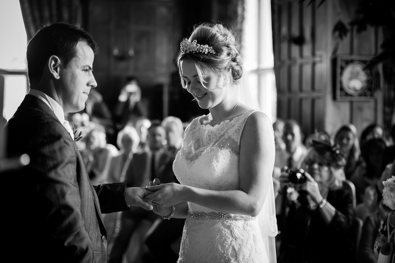 Bride and groom exchanging rings. Wedding at Chateaux Rhianfa, Anglesey. Wedding Photographer, Celynnen Photography
