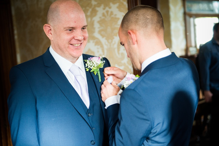 Groom preparing for wedding by North Wales Wedding Photographer Celynnen Photography