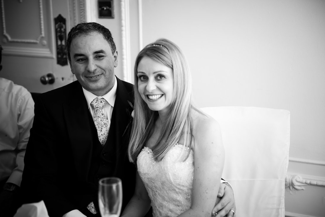 Black and white image of the bride and groom after the speeches at their wedding at Taplow House, Buckinghamshire.
