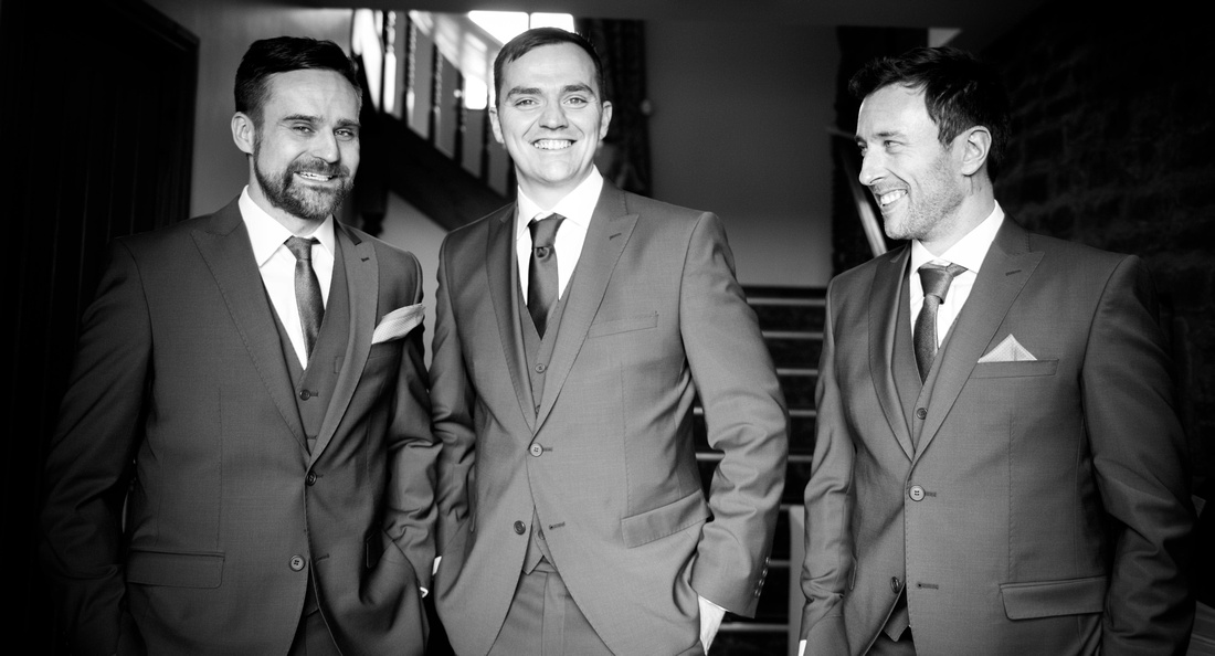 Black and white portrait of the groom with his best men on his wedding day at Beeston Manor.
