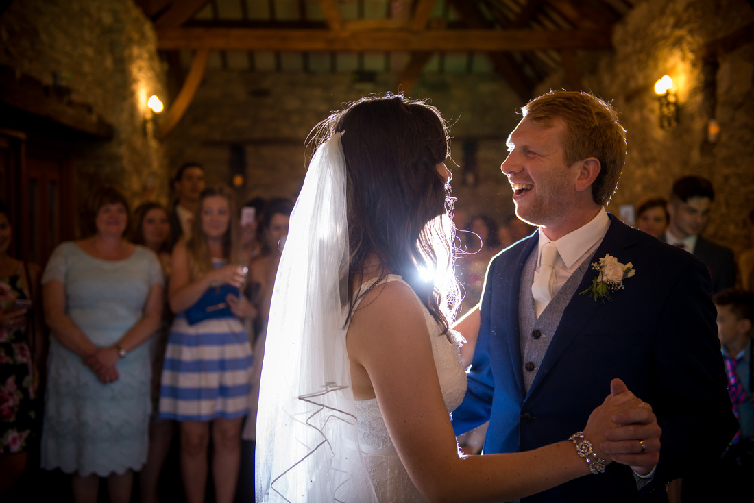 Image of the bride and groom enjoying their first dance at their wedding at Plas Isaf.
