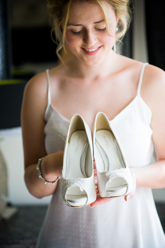 Bride and her shoes for her wedding at Chateaux Rhianfa, Anglesey. Wedding Photographer, Celynnen Photography